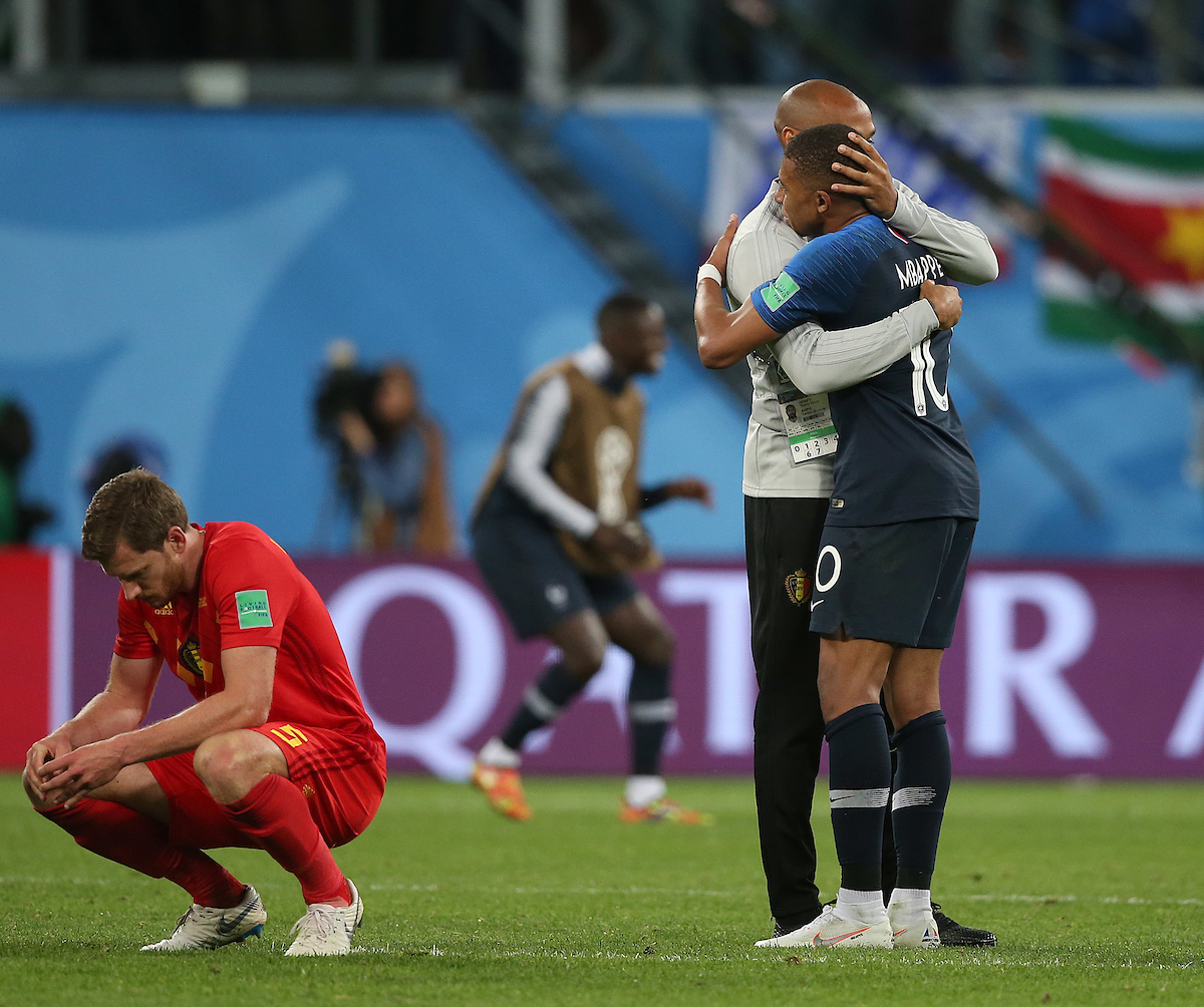 Jan Vertonghen of Belgium looks dejected as Belgium Assistant Manager Thierry Henry hugs Kylian Mbappe of France at the end of the 2018 FIFA World Cup match at St Petersburg Stadium, St Petersburg Picture by Paul Chesterton/Focus Images Ltd +44 7904 640267 10/07/2018