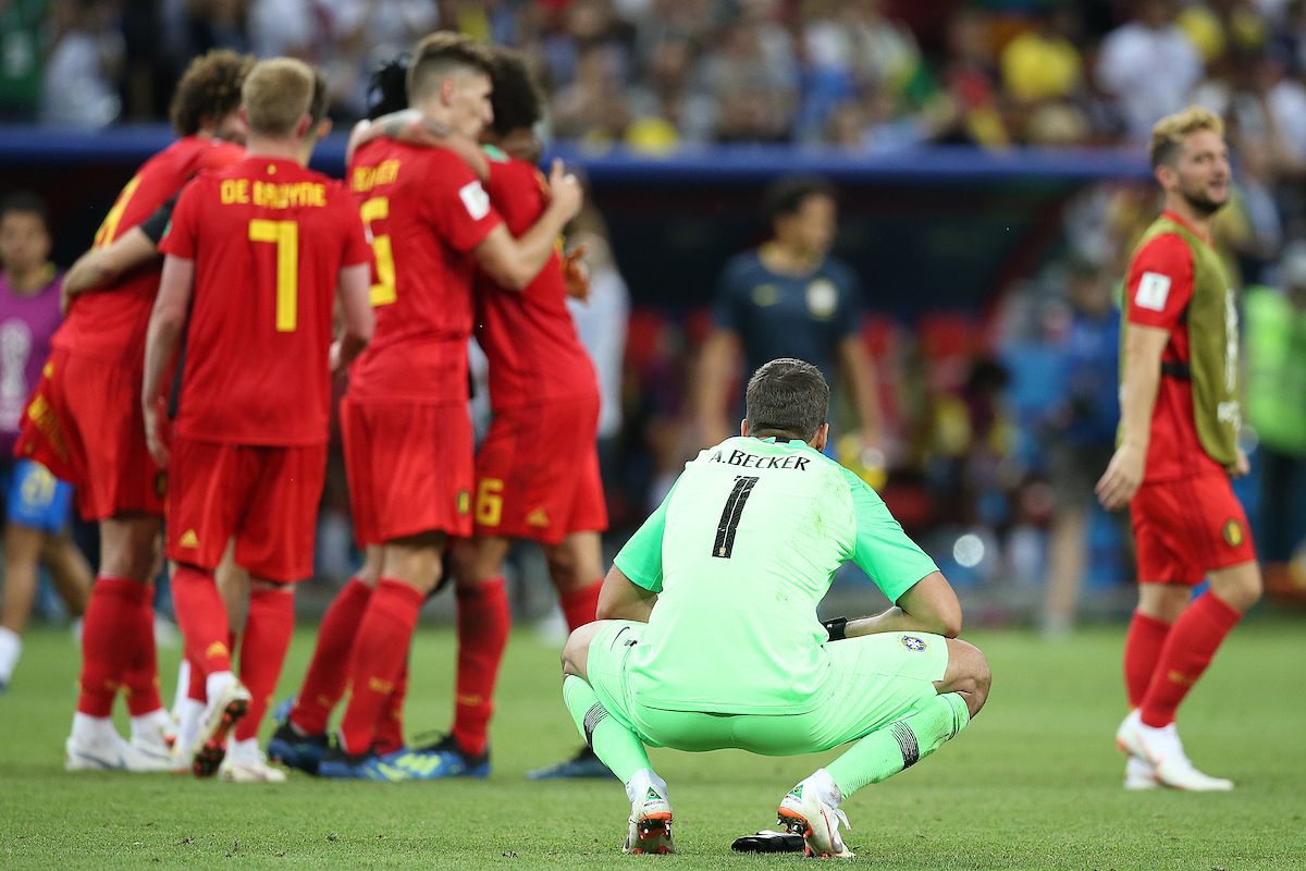 Alisson Becker of Brazil looks dejected as the the Belgium players celebrate victory at the end of the 2018 FIFA World Cup Quarter-Final match at Kazan Arena, Kazan Picture by Paul Chesterton/Focus Images Ltd +44 7904 640267 06/07/2018