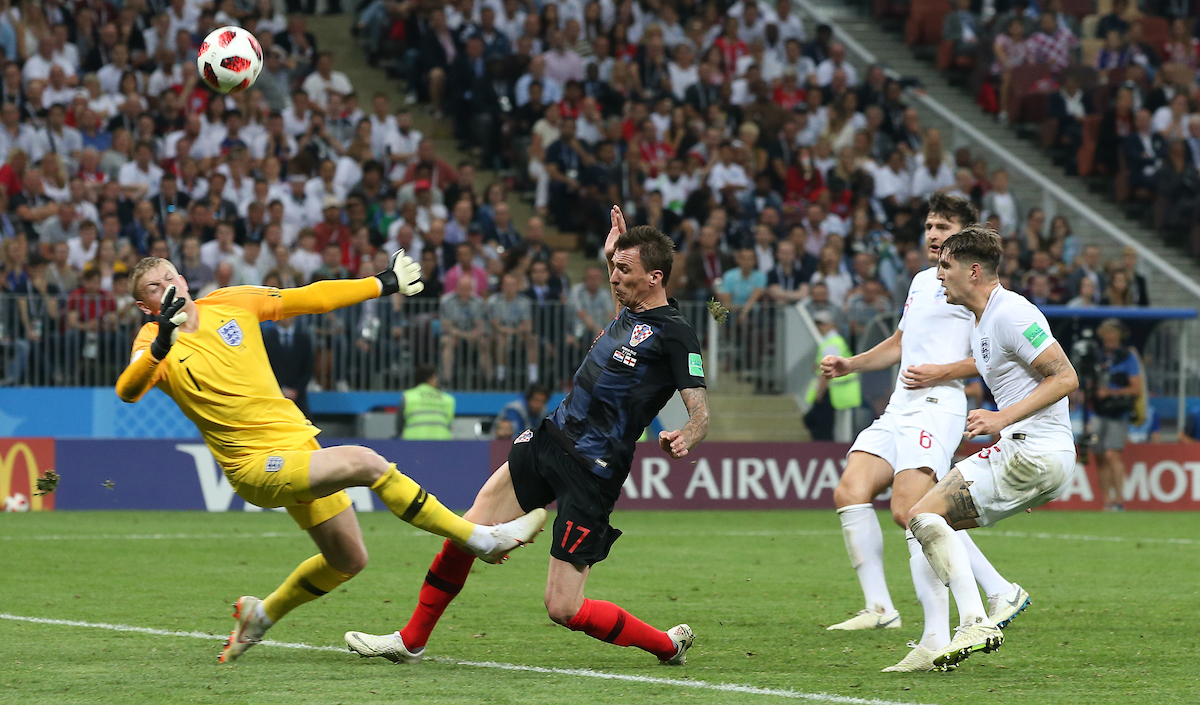 Mario Mandzukic of Croatia is tackled by Jordan Pickford of England during the 2018 FIFA World Cup match at Luzhniki Stadium, Moscow Picture by Paul Chesterton/Focus Images Ltd +44 7904 640267 11/07/2018