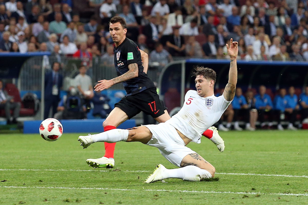 John Stones of England and Mario Mandzukic of Croatia in action during the 2018 FIFA World Cup Semi Final match at Luzhniki Stadium, Moscow Picture by Paul Chesterton/Focus Images Ltd +44 7904 640267 11/07/2018