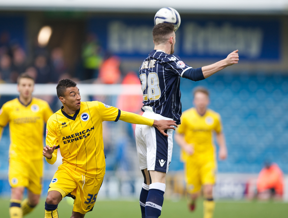 Scott Malone of Millwall heads the ball cldar of Jesse Lingard of Brighton and Hove Albion during the Sky Bet Championship match at The Den, London Picture by Alan Stanford/Focus Images Ltd +44 7915 056117 01/03/2014