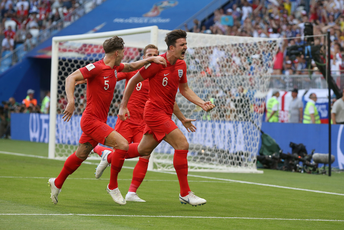 Harry Maguire of England celebrates scoring their first goal with John Stones and Harry Kane during the 2018 FIFA World Cup Quarter-Final match at Samara Arena, Samara Picture by Paul Chesterton/Focus Images Ltd +44 7904 640267 07/07/2018
