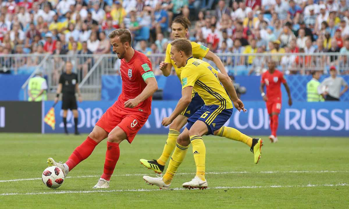 Harry Kane of England gets his pass away despite pressure from Ludwig Augustinsson of Sweden during the 2018 FIFA World Cup Quarter-Final match at Samara Arena, Samara Picture by Paul Chesterton/Focus Images Ltd +44 7904 640267 07/07/2018