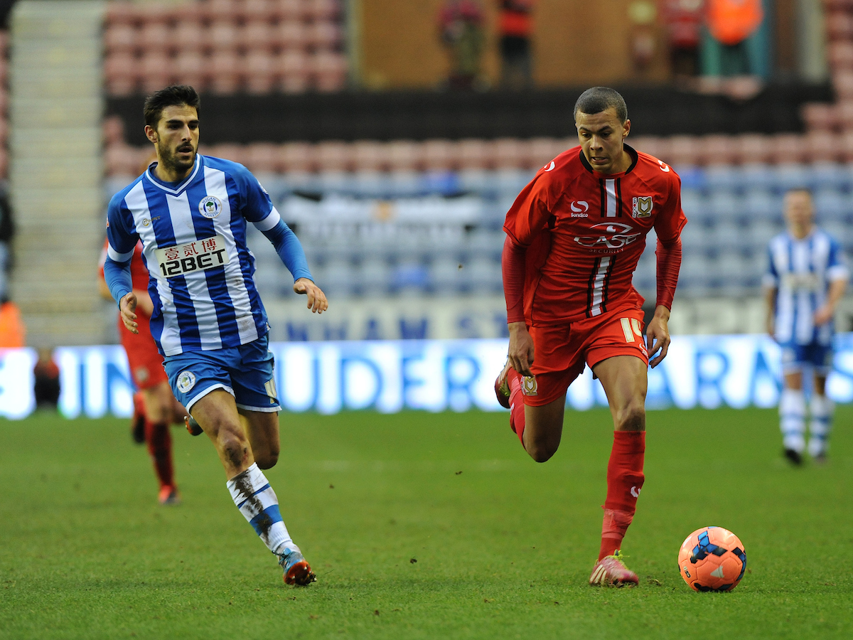 Picture by Alan Wright/Focus Images Ltd 07733 196489 04/01/2014 Dele Alli of Milton Keynes Dons and Jordi Gomez of Wigan Athletic in action during the The FA Cup match at the DW Stadium, Wigan.