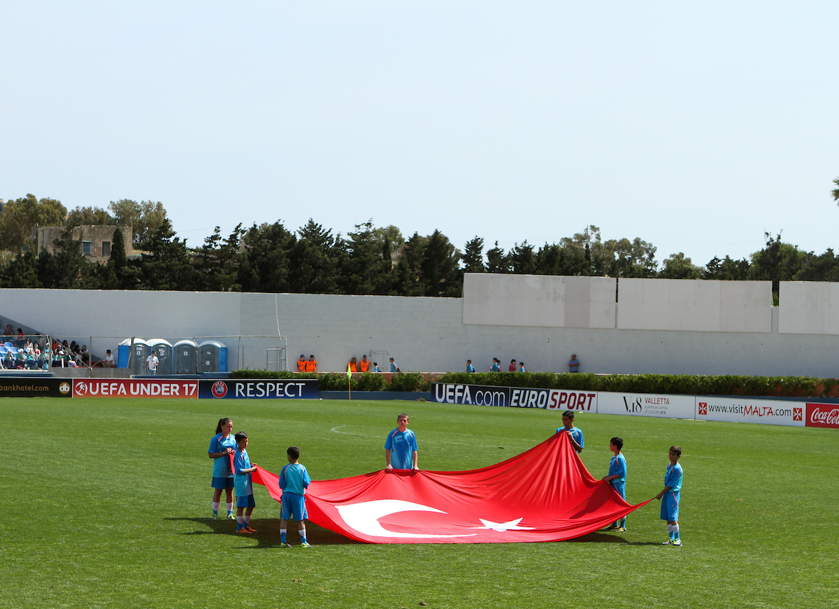 The flag of Turkey is held up by Uefa mascots before the 2014 UEFA European Under-17 match at Gozo Stadium, Xewkija Picture by Tom Smith/Focus Images Ltd 07545141164 12/05/2014