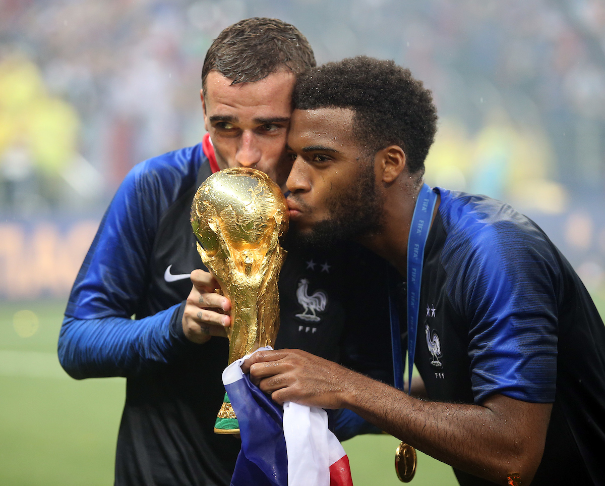 Antoine Griezmann of France and Thomas Lemar of France with the trophy at the end of the 2018 FIFA World Cup Final match at Luzhniki Stadium, Moscow Picture by Paul Chesterton/Focus Images Ltd +44 7904 640267 15/07/2018