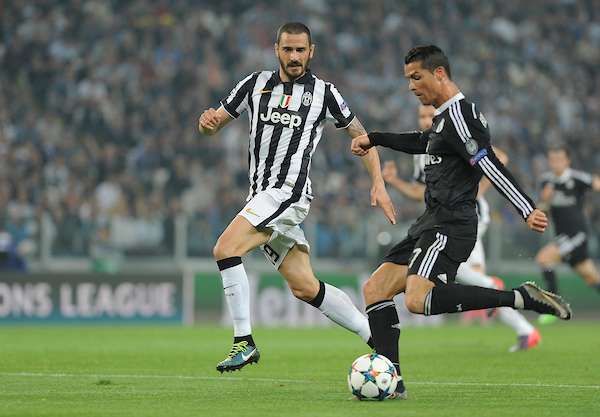 Leonardo Bonucci (left) of Juventus and Cristiano Ronaldo of Real Madrid during the UEFA Champions League semi final, first leg at Juventus Stadium, Turin Picture by Stefano Gnech/Focus Images Ltd +39 333 1641678 05/05/2015