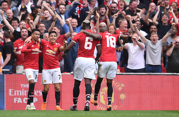 Alexis Sanchez of Manchester United celebrates scoring their first goal with team mates Jesse Lingard, Paul Pogba and Ashley Young during the FA Cup Semi-Final match against Tottenham Hotspur at Wembley Stadium, London Picture by Andrew Timms/Focus Images Ltd +44 7917 236526 21/04/2018