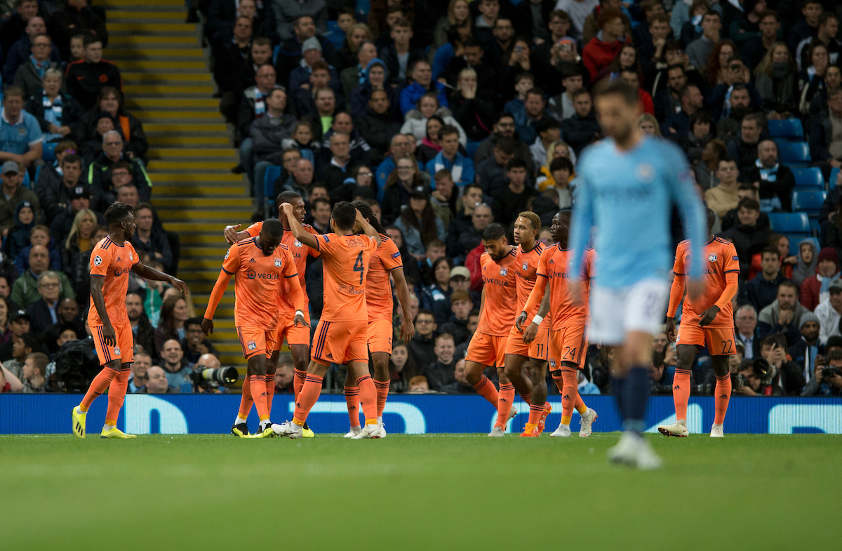 Lyon players celebrate after their ream go 1-0 up, as Bernardo Silva of Manchester City has a look of dejection in the foreground during the UEFA Champions League match at the Etihad Stadium, Manchester Picture by Russell Hart/Focus Images Ltd 07791 688 420 19/09/2018