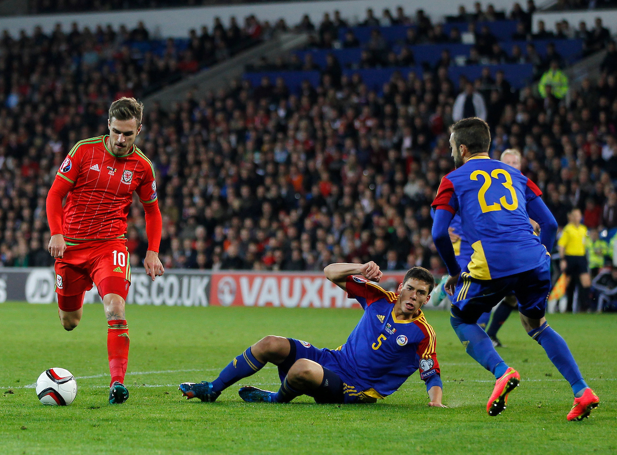 Aaron Ramsey of Wales and Max Llovera of Andorra during the UEFA Euro 2016 Qualifying match at the Cardiff City Stadium, Cardiff Picture by Mike Griffiths/Focus Images Ltd +44 7766 223933 13/10/2015