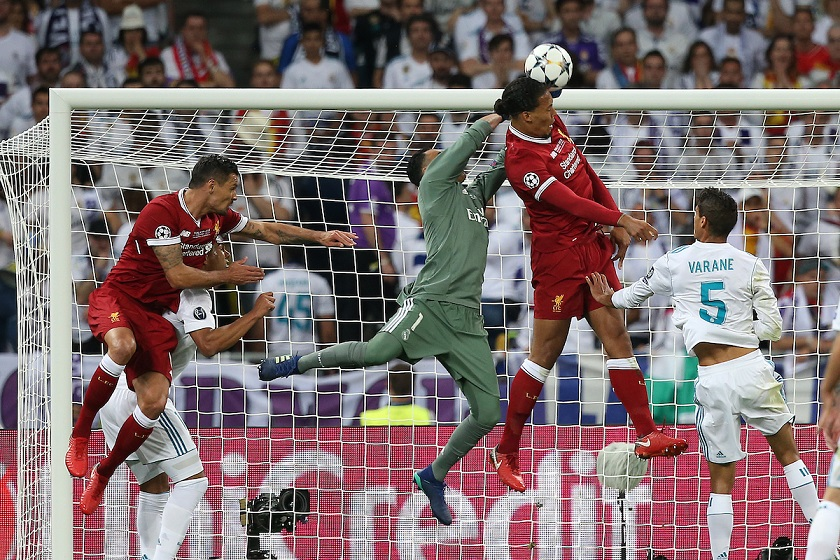 Keylor Navas of Real Madrid punches clear ahead of Virgil van Dijk of Liverpool during the UEFA Champions League Final at the Olympic Stadium, Kiev Picture by Paul Chesterton/Focus Images Ltd +44 7904 640267 26/05/2018