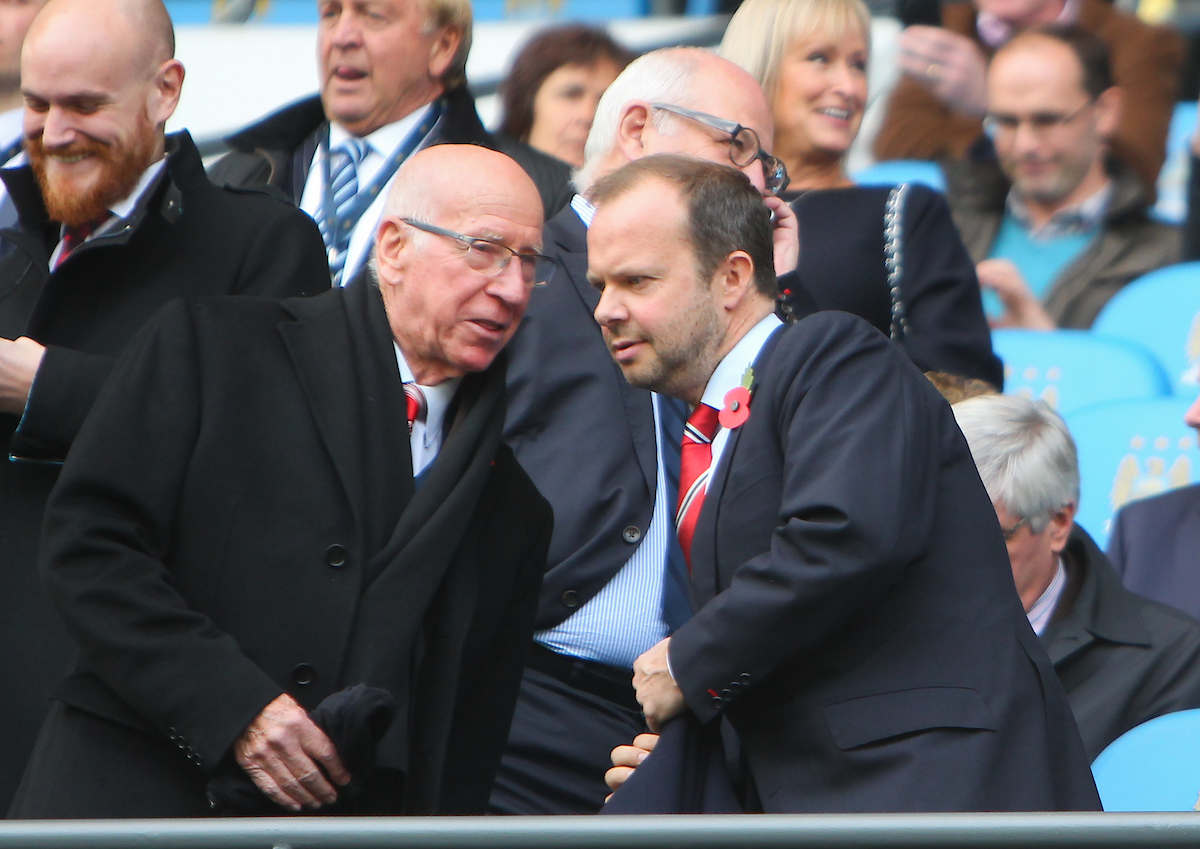 Manchester United director Sir Bobby Charlton speaks to Chief Exec Officer Ed Woodward during the Barclays Premier League match at the Etihad Stadium, Manchester Picture by John Rainford/Focus Images Ltd +44 7506 538356 02/11/2014