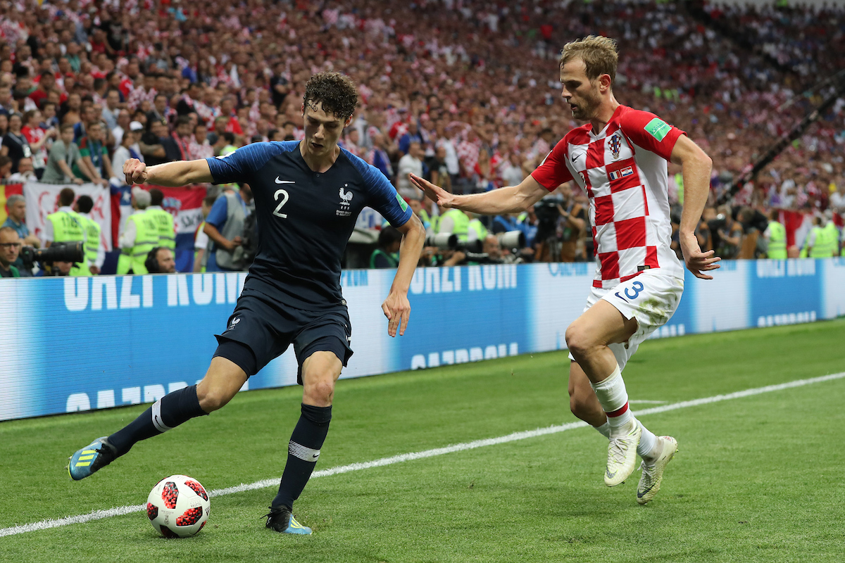 Benjamin Pavard of France and Ivan Strinic of Croatia in action during the 2018 FIFA World Cup Final match at Luzhniki Stadium, Moscow Picture by Paul Chesterton/Focus Images Ltd +44 7904 640267 15/07/2018