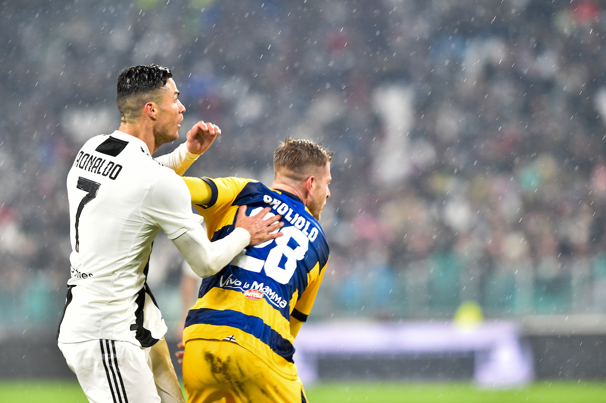 Cristiano Ronaldo of Juventus tussles with Gagliolo Riccardo of Parma Calcio 1913 during the Serie A match at Juventus Stadium, Turin Picture by Antonio Polia/Focus Images Ltd +393473147935 02/02/2019