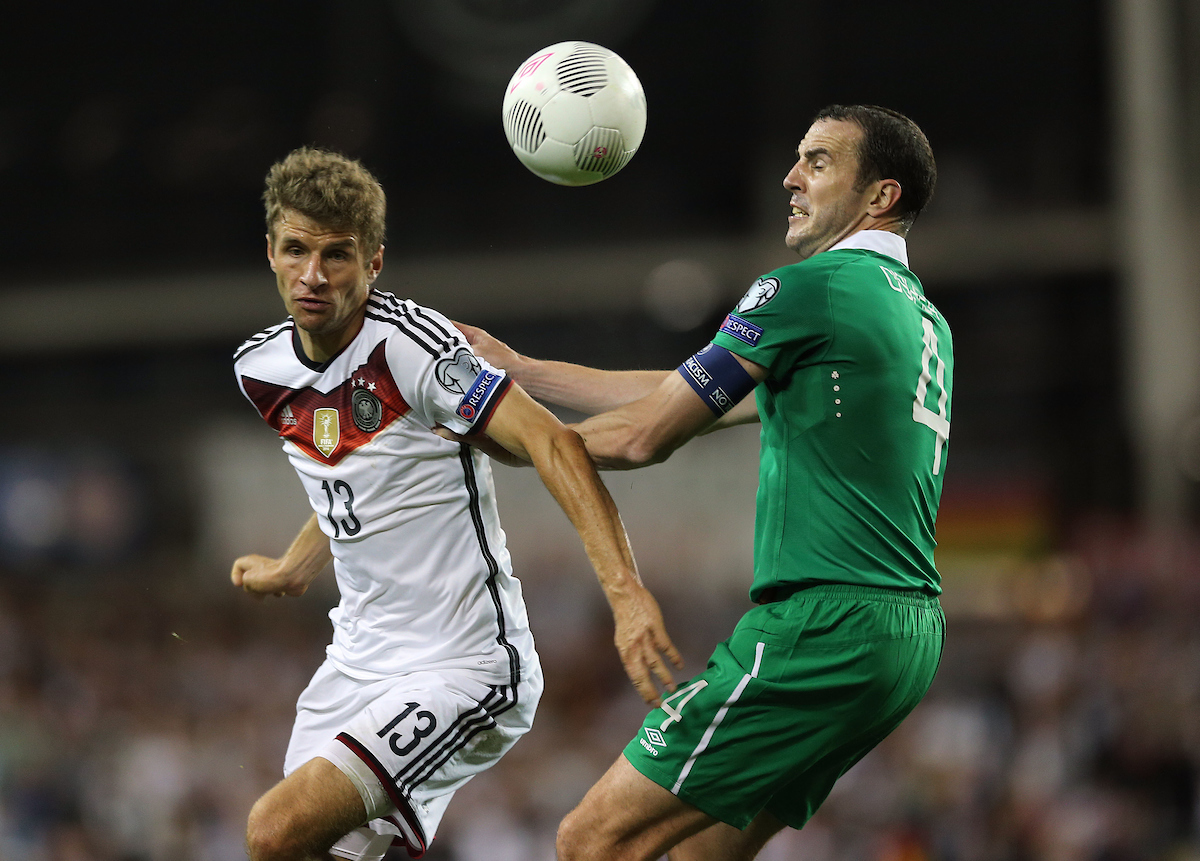 John O'Shea of Republic of Ireland and Thomas Müller of Germany during the UEFA Euro 2016 Qualifying match at the Aviva Stadium, Dublin Picture by Lorraine O'Sullivan/Focus Images Ltd +353 872341584 08/10/2015