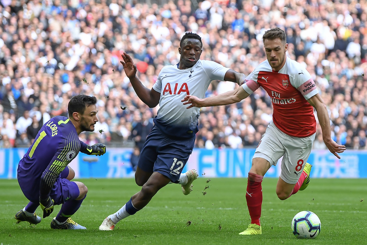 Aaron Ramsey of Arsenal goes around Tottenham Hotspur Goalkeeper Hugo Lloris and Victor Wanyama to score the opening goal of the game during the Premier League match at Wembley Stadium, London Picture by Martyn Haworth/Focus Images Ltd 07463250714 02/03/2019