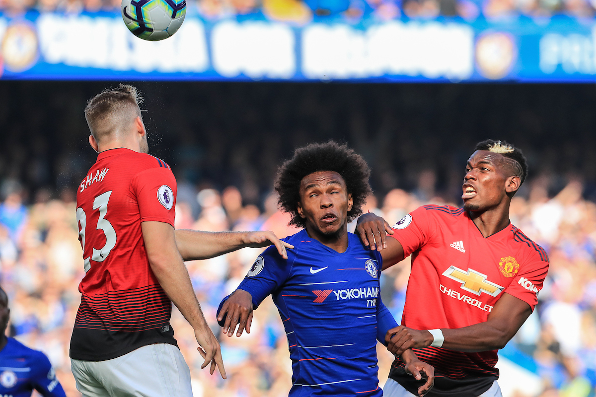 Willian of Chelsea between Paul Pogba and Luke Shaw of Manchester United during the Premier League match at Stamford Bridge, London Picture by Romena Fogliati/Focus Images Ltd 07576143919 20/10/2018