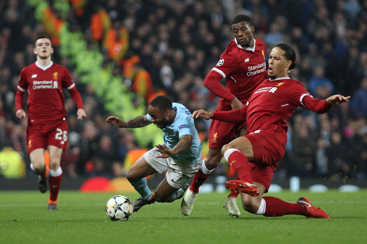 Raheem Sterling of Manchester City goes down after a tackle by Virgil van Dijk of Liverpool during the UEFA Champions League Quarter Final match at the Etihad Stadium, Manchester. Picture by Michael Sedgwick/Focus Images Ltd +44 7900 363072 10/04/2018