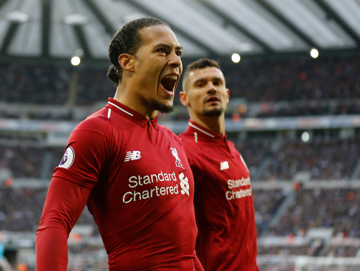 Virgil van Dijk (l) of Liverpool celebrates scoring the opening goal during the Premier League match at St. James's Park, Newcastle Picture by Simon Moore/Focus Images Ltd 07807 671782 04/05/2019