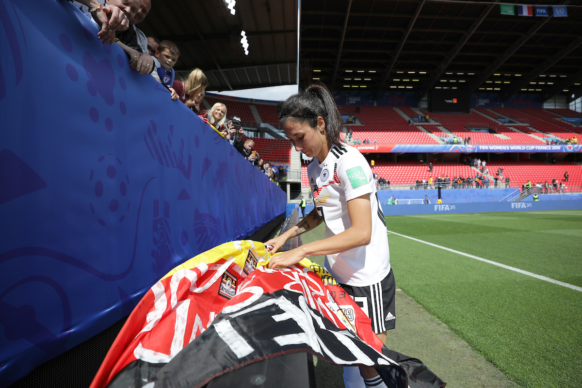 Sara Däbritz of Germany Women signs autographs for fans during the FIFA Women's World Cup 2019 match at Roazhon Park, Rennes Picture by Kunjan Malde/Focus Images Ltd +447523653989 08/06/2019