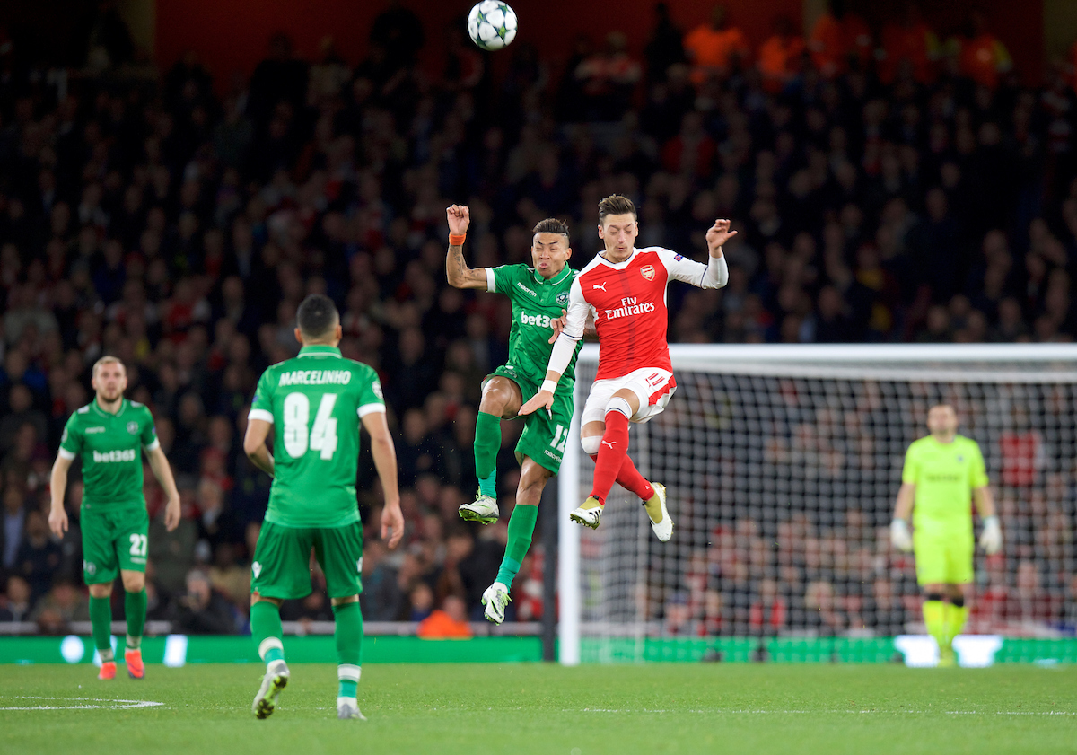 Mesut Ozil of Arsenal wins the header from Anicet of Ludogorets Razgrad during the UEFA Champions League match at the Emirates Stadium, London Picture by Alan Stanford/Focus Images Ltd +44 7915 056117 19/10/2016