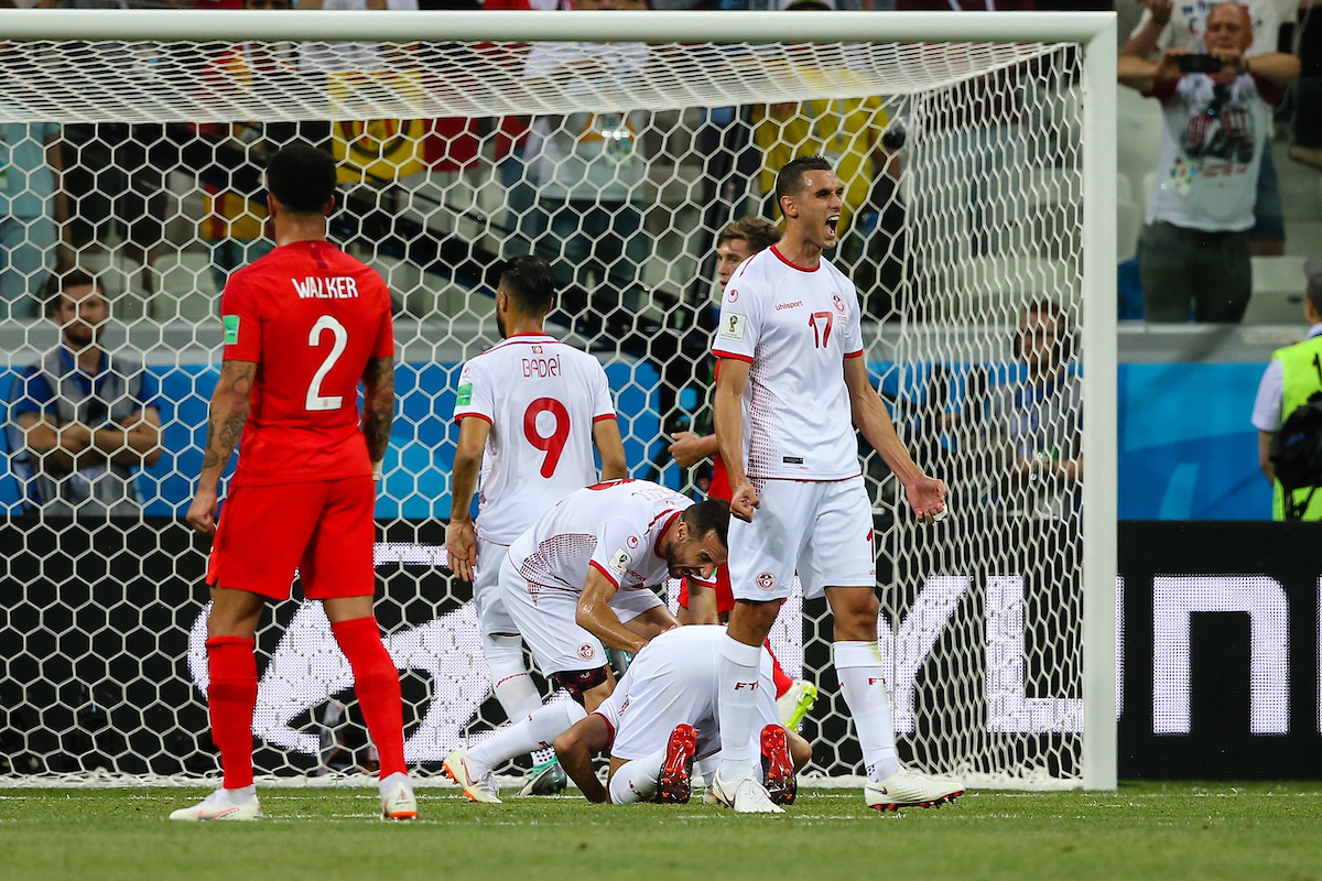 Ferjani Sassi of Tunisia celebrates scoring their first goal (penalty) with team mates against Jordan Pickford of England during the England v Tunisia 2018 FIFA World Cup match at Volgograd Arena, Volgograd Picture by Paul Chesterton/Focus Images Ltd +44 7904 640267 18/06/2018