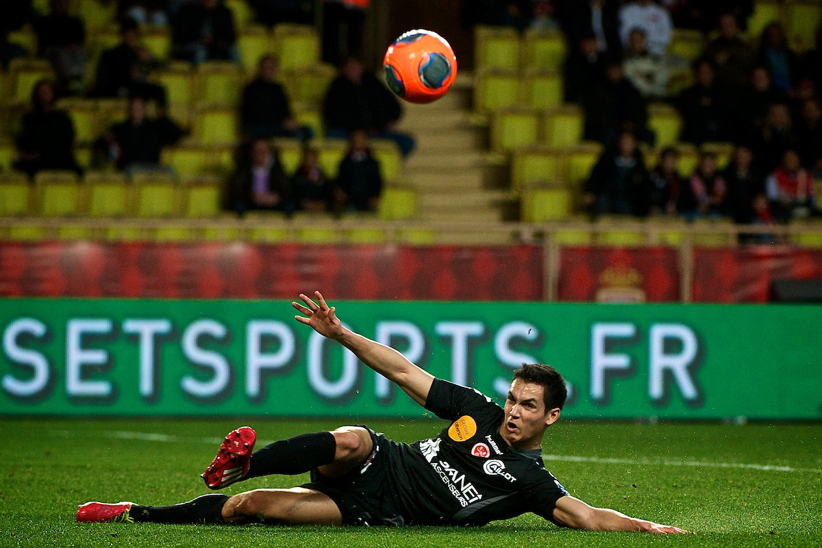 Aïssa Mandi of Stade de Reims makes a sliding clearance during the Ligue 1 match at Stade Louis II, Fontvieille Picture by Ian Wadkins/Focus Images Ltd +44 7877 568959 21/02/2014