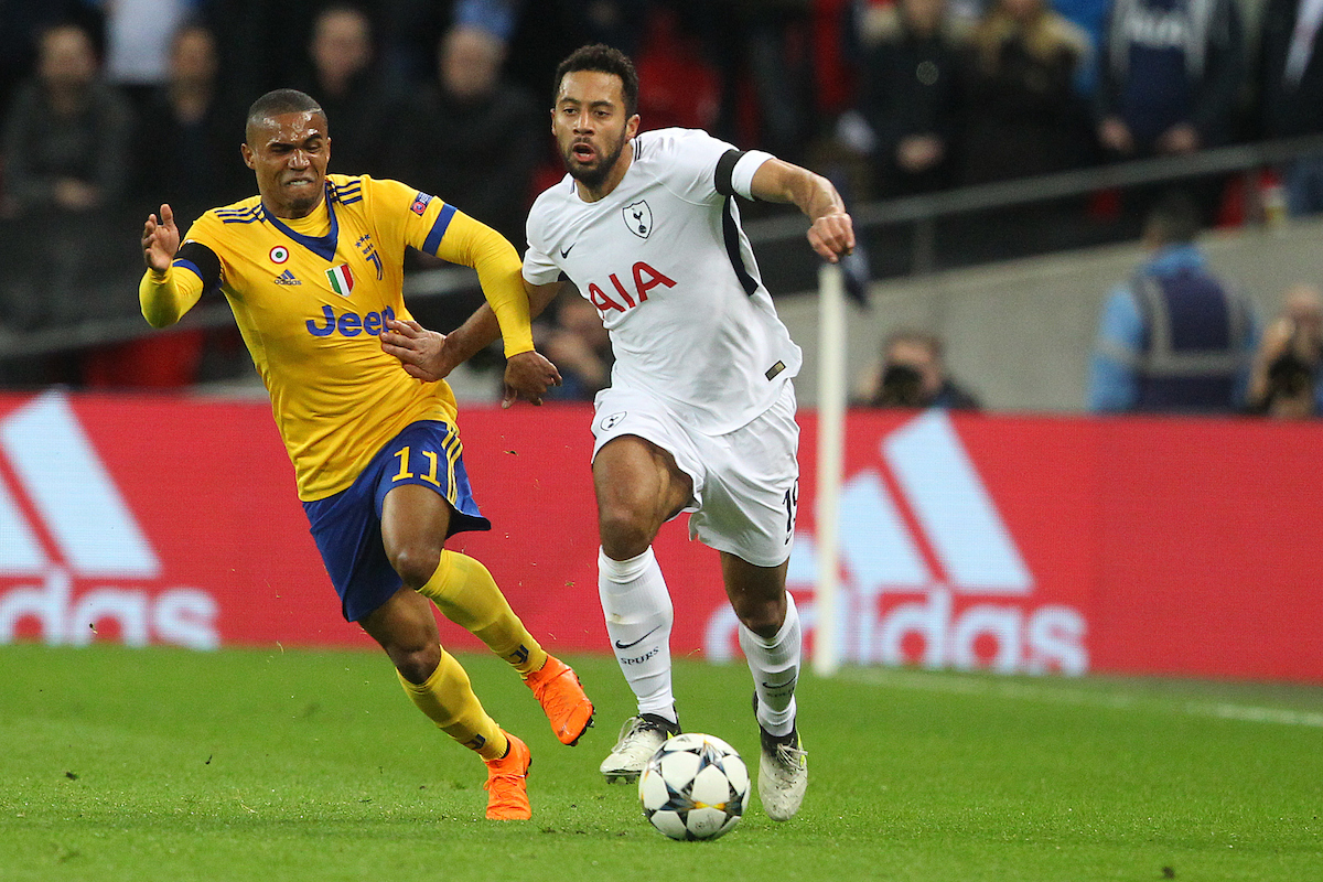 Douglas Costa of Juventus and Mousa Dembele of Tottenham Hotspur in action during the UEFA Champions League match at Wembley Stadium, London Picture by Paul Chesterton/Focus Images Ltd +44 7904 640267 06/03/2018