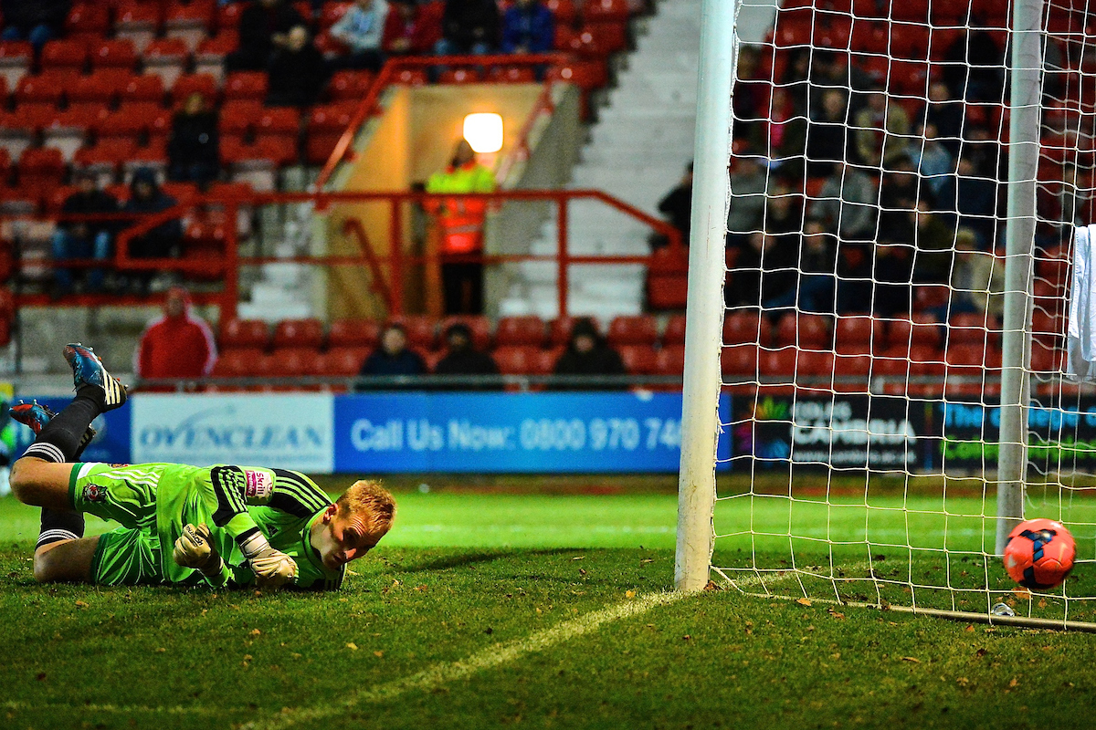 Picture by Ian Wadkins/Focus Images Ltd +44 7877 568959 09/12/2013 Andy Coughlin of Wrexham watches a shot go narrowly wide of his goal during the FA Cup second round match at Racecourse Ground, Wrexham.