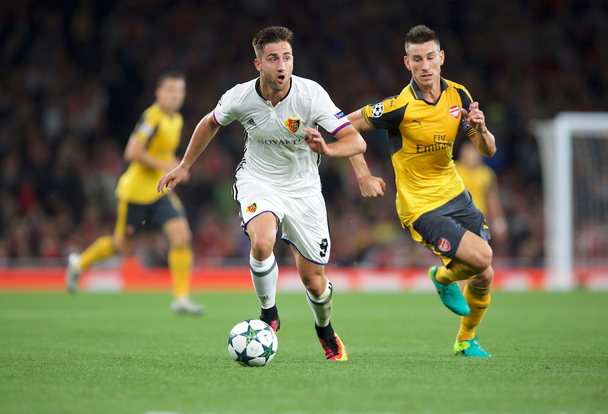 Andraz Sporar of FC Basel goes past Laurent Koscielny of Arsenal during the UEFA Champions League match at the Emirates Stadium, London Picture by Alan Stanford/Focus Images Ltd +44 7915 056117 28/09/2016