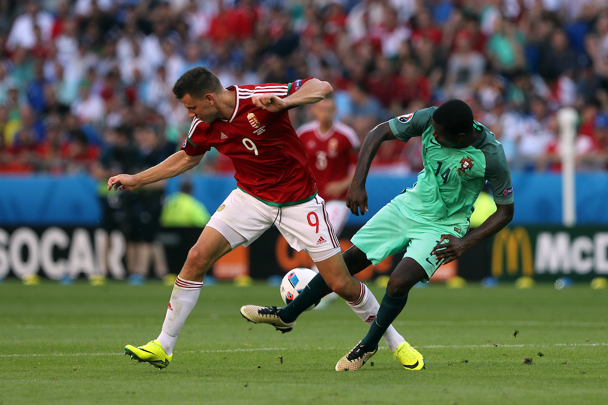 William Carvalho of Portugal and Adam Szalai of Hungary during the UEFA Euro 2016 match at Stade de Lyons, Lyons Picture by Paul Chesterton/Focus Images Ltd +44 7904 640267 22/06/2016