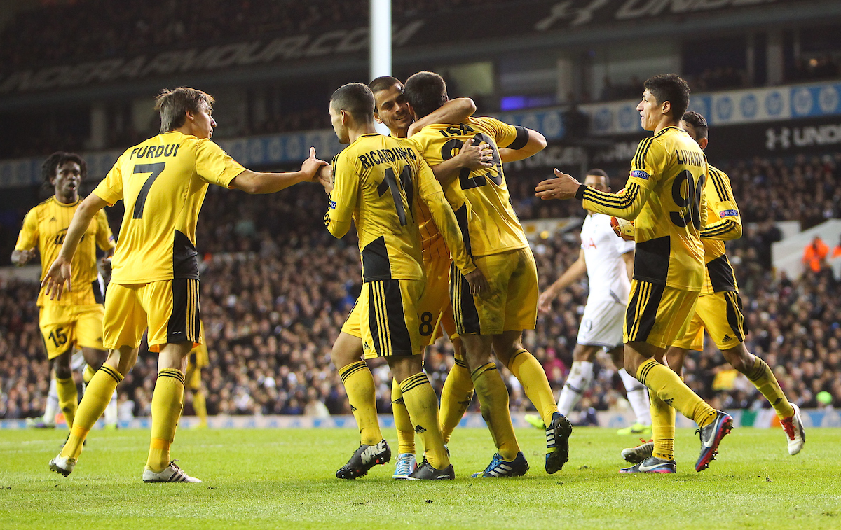 Picture by John Rainford/Focus Images Ltd +44 7506 538356 07/11/2013 Ismail Isa of FC Sheriff Tiraspol is congratulated by team-mates after scoring against Tottenham Hotspur during the UEFA Europa League match at White Hart Lane, London.