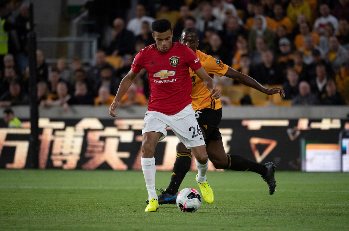 Mason Greenwood of Manchester United collects the ball as Willy Boly of Wolverhampton Wanderers closes down during the Premier League match at Molineux, Wolverhampton Picture by Russell Hart/Focus Images Ltd 07791 688 420 19/08/2019