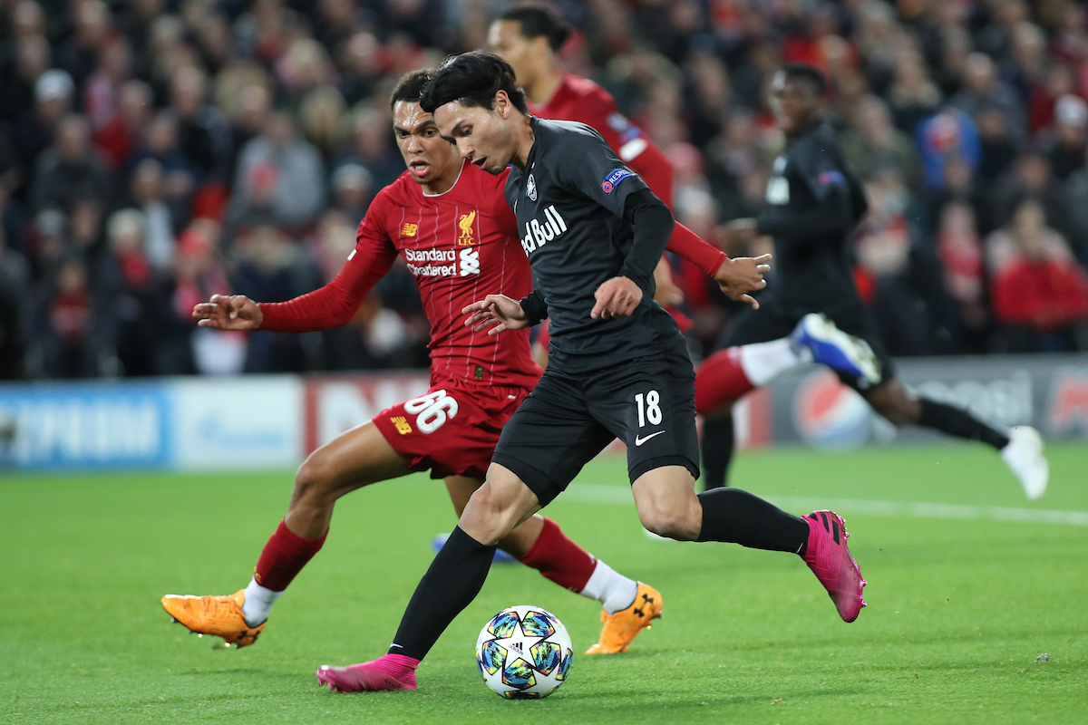 Takumi Minamino of Red Bull Salzburg and Trent Alexander-Arnold of Liverpool in action during the UEFA Champions League match at Anfield, Liverpool. Picture by Michael Sedgwick/Focus Images Ltd +44 7900 363072 02/10/2019