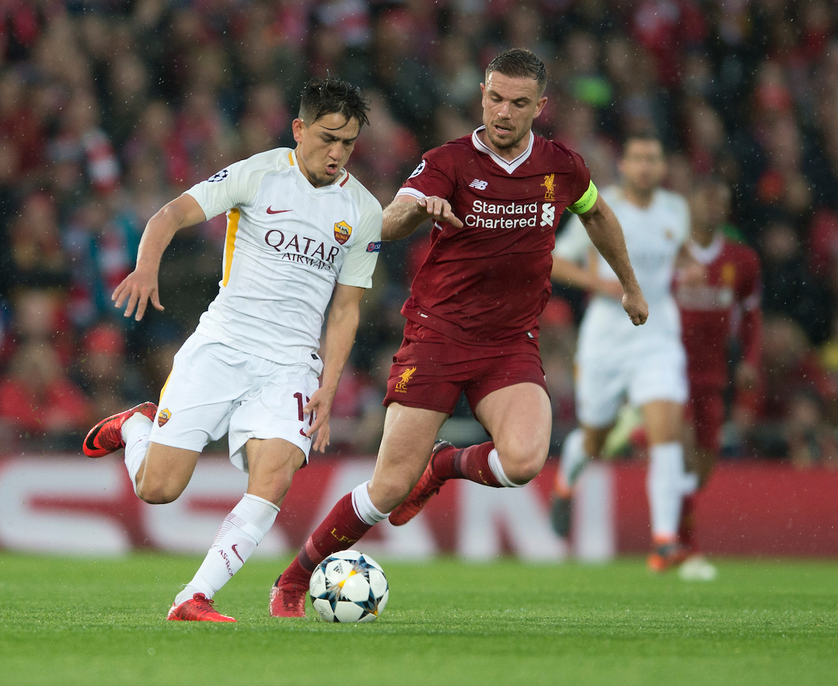Cengiz Under of AS Roma (left) looks to pull away from Jordan Henderson of Liverpool during the UEFA Champions League Semi-Final match at Anfield, Liverpool Picture by Russell Hart/Focus Images Ltd 07791 688 420 24/04/2018