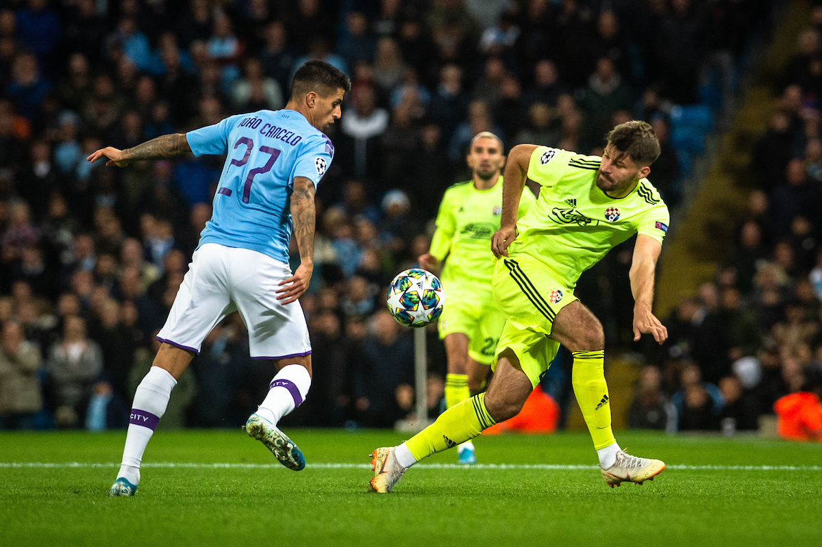 Joao Cancelo of Manchester City clashes with Bruno Petkovic of Dinamo Zagreb during the UEFA Champions League match at the Etihad Stadium, Manchester Picture by Matt Wilkinson/Focus Images Ltd 07814 960751 01/10/2019