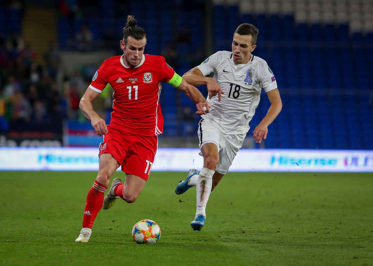 Gareth Bale of Wales fights off Anton Krivotsyuk of Azerbaijan during the UEFA Euro 2020 Qualifiers match at the Cardiff City Stadium, Cardiff Picture by Matthew Lofthouse/Focus Images Ltd 07703 390510 06/09/2019