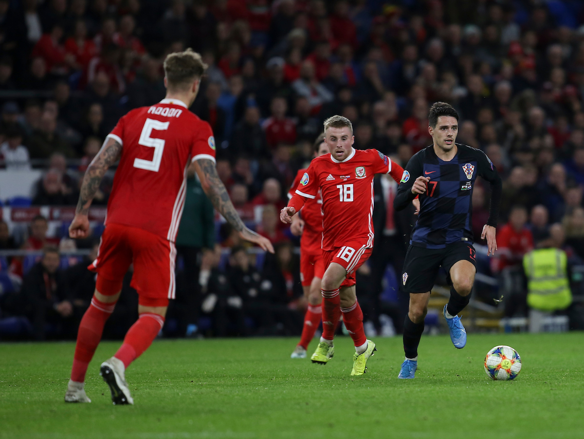 Joe Morrell of Wales and Josip Brekalo of Croatia during the UEFA Euro 2020 Qualifiers match at the Cardiff City Stadium, Cardiff Picture by Mike Griffiths/Focus Images Ltd +44 7766 223933 13/10/2019
