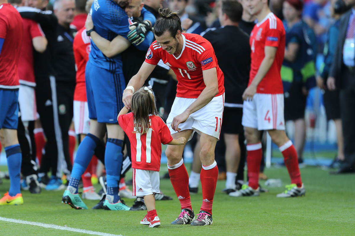 Gareth Bale of Wales dances with his daughter Alba Violet at the end of the UEFA Euro 2016 match at Parc des Princes, Paris Picture by Paul Chesterton/Focus Images Ltd +44 7904 640267 25/06/2016
