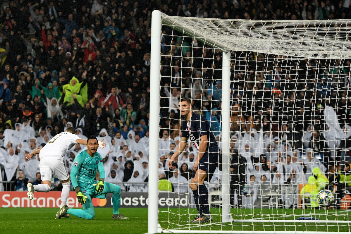 Karim Benzema of Real Madrid (centre) celebrates scoring their first goal to make it Real Madrid 1 Paris Saint-Germain 0 during the UEFA Champions League match at the Estadio Santiago Bernabeu, Madrid Picture by Kristian Kane/Focus Images Ltd +44 7814 482222 26/11/2019