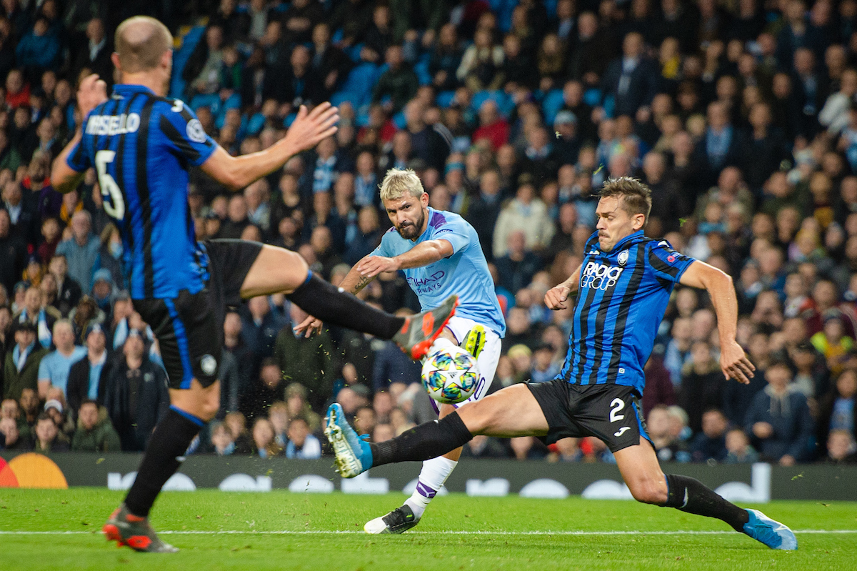 Sergio Aguero of Manchester City with a strike on goal despite the attention of Rafael Toloi (right) and Andrea Masiello of Atalanta BC during the UEFA Champions League match at the Etihad Stadium, Manchester Picture by Matt Wilkinson/Focus Images Ltd 07814 960751 22/10/2019