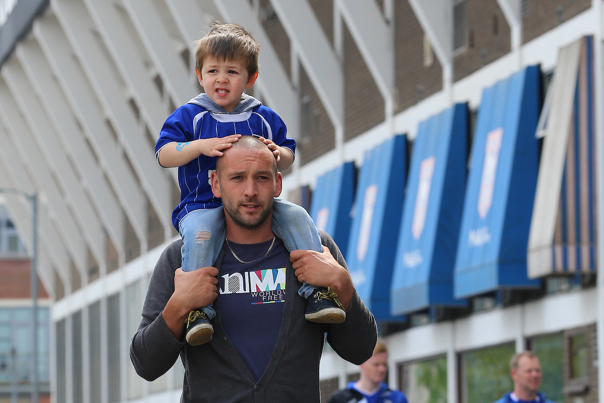 Father and son before the Sky Bet Championship match between Ipswich Town and Bournemouth at Portman Road, Ipswich Picture by Richard Calver/Focus Images Ltd +447792 981244 21/04/2014