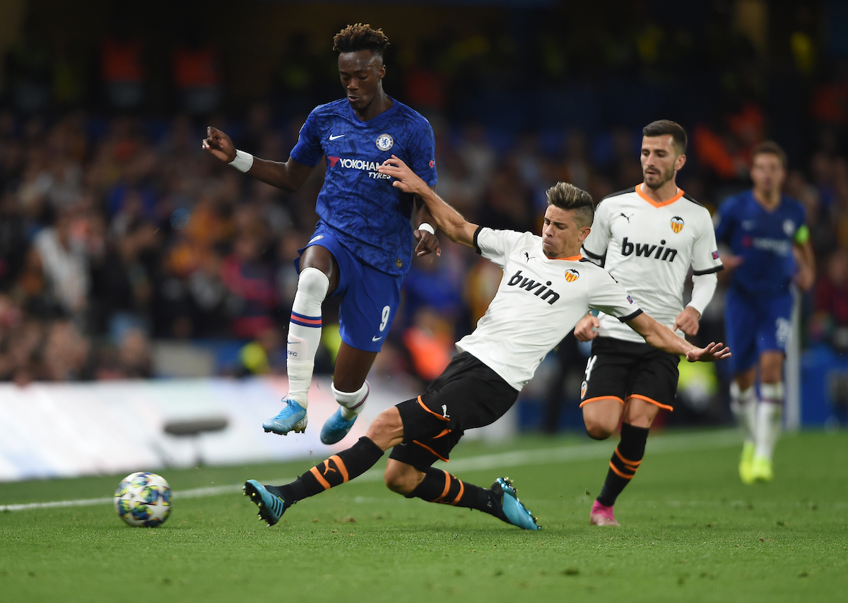 Valencia's Jose Gaya tackles Chelsea's Tammy Abraham during the UEFA Champions League match at Stamford Bridge, London Picture by Daniel Hambury/Focus Images Ltd 07813022858 17/09/2019