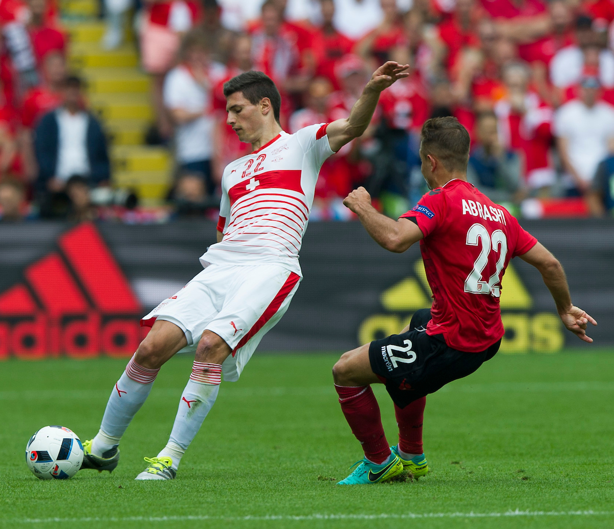 Fabian Schär of Switzerland and 1899 Hoffenheim kicks the ball past Amir Abrashi of Albania and SC Freiburg during the EURO 2016 match at Stade Bollaert-Delelis , Lens Picture by Anthony Stanley/Focus Images Ltd 07833 396363 11/06/2016