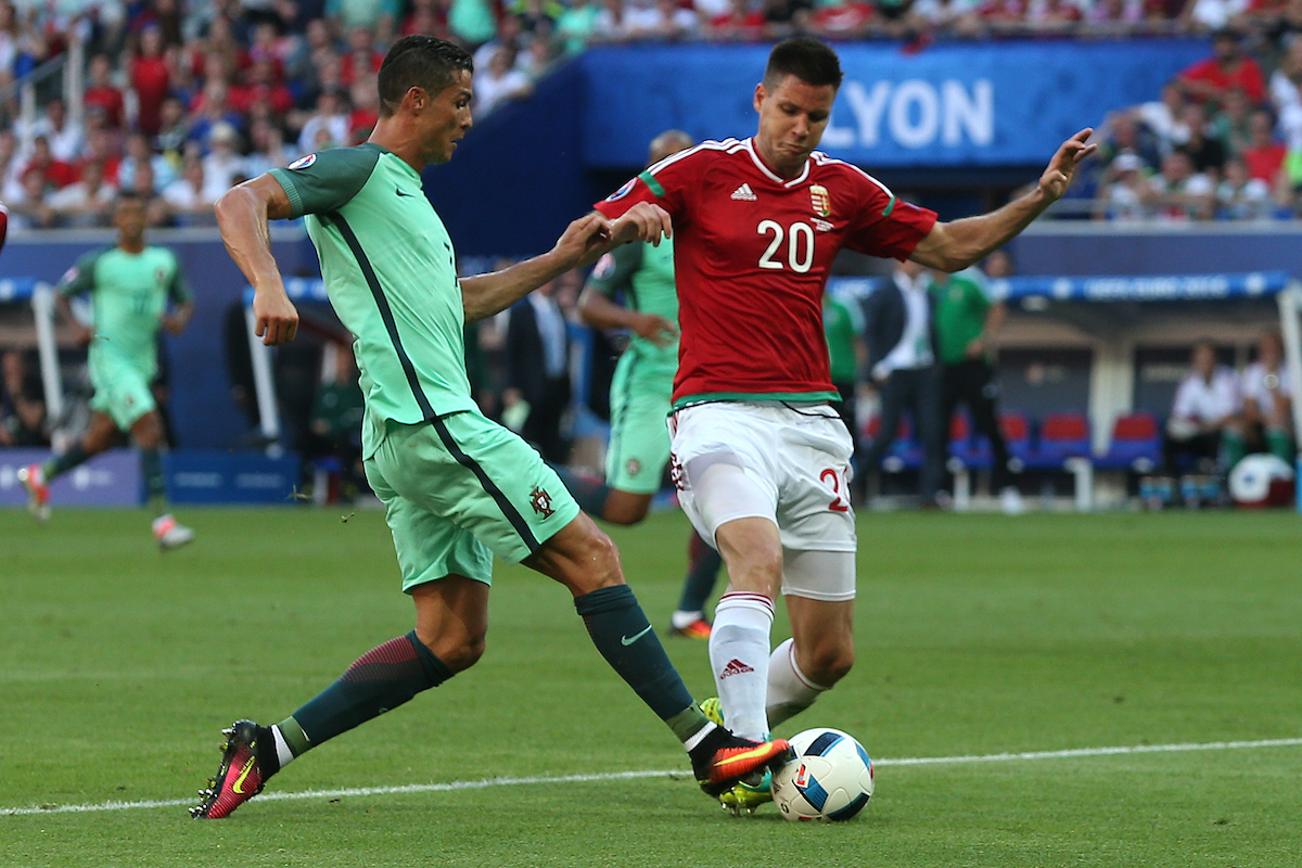 Cristiano Ronaldo of Portugal and Richard Guzmics of Hungary during the UEFA Euro 2016 match at Stade de Lyons, Lyons Picture by Paul Chesterton/Focus Images Ltd +44 7904 640267 22/06/2016