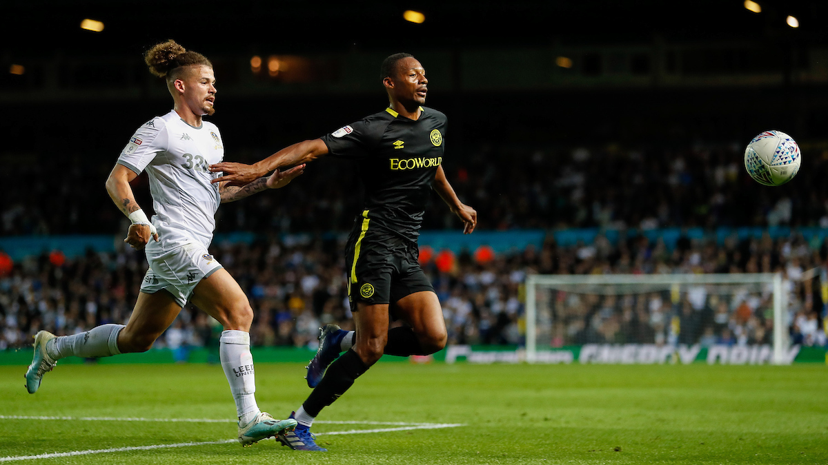 Kalvin Phillips of Leeds United and Ethan Pinnock of Brentford during the Sky Bet Championship match between Leeds United and Brentford at Elland Road, Leeds Picture by Mark D Fuller/Focus Images Ltd +44 7774 216216 21/08/2019
