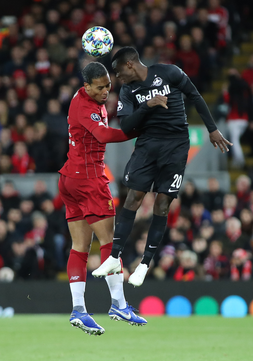 Virgil van Dijk of Liverpool and Patson Daka of Red Bull Salzburg in action during the UEFA Champions League match at Anfield, Liverpool. Picture by Michael Sedgwick/Focus Images Ltd +44 7900 363072 02/10/2019