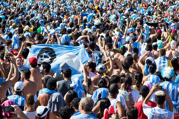 Argentina fans with a flag with Maradona's face on it react to the first goal being scored at the FIFA Fan Fest, Copacabana beach, Rio de Janeiro, during the Argentina v Belgium World Cup quarter final match which was shown on big screens. Picture by Andrew Tobin/Focus Images Ltd +44 7710 761829 05/07/2014