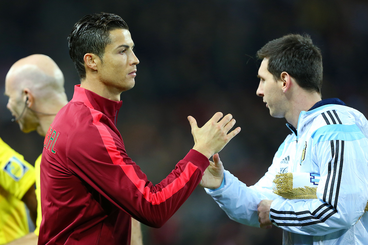Cristiano Ronaldo of Portugal shake hands with Lionel Messi of Argentina before the International Friendly match at Old Trafford, Manchester Picture by Richard Calver/Focus Images Ltd +447792 981244 18/11/2014