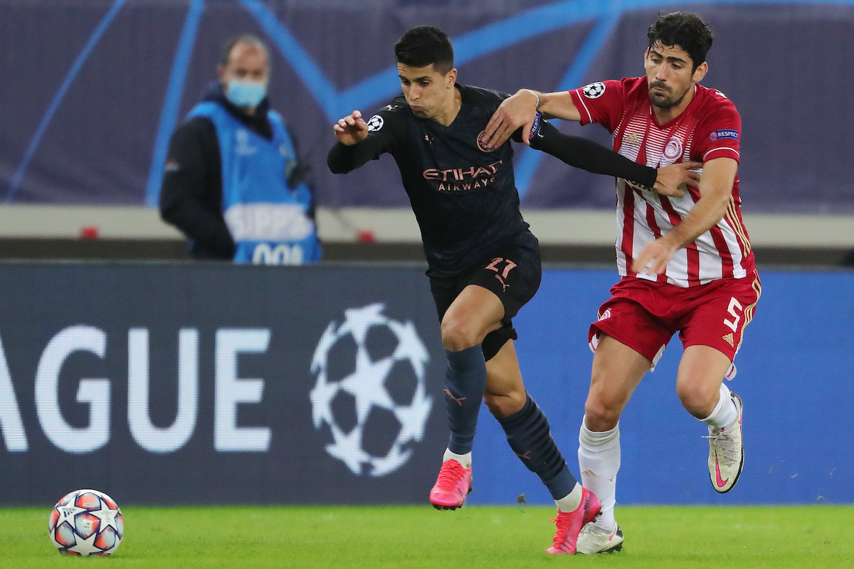 Andreas Bouchalakis of Olympiacos F.C. and João Cancelo of Manchester City during the UEFA Champions League match at Karaiskakis Stadium, Piraeus Picture by Yannis Halas/Focus Images Ltd +353 8725 82019 25/11/2020